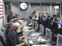 UMD's Michael A'Hearn (bottom left) and other EPOXI team members in JPL mission control after closest flyby.