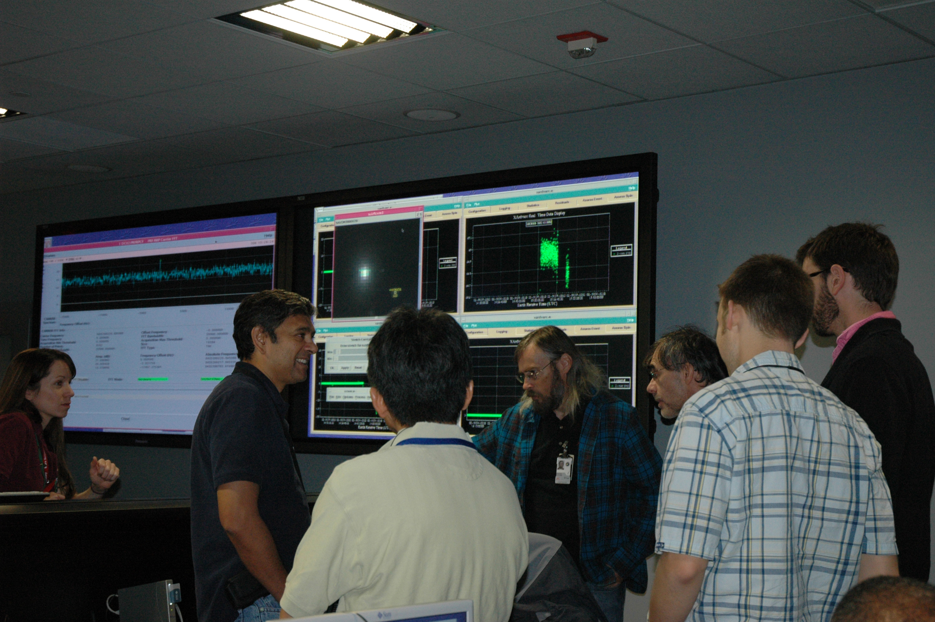 EPOXI navigation team members and engineers in mission control.