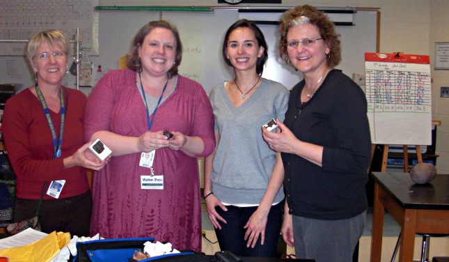 L to R: Polly Rouhan, Marylyn Salagaj, Carolyn Crow, Valorie Wright. Apparently holding a real space rock is much more exciting than holding a model of one (3-D model of the nucleus of Tempel 1 sits on the table in the background)!