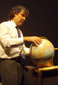 Dr. Jeff Goldstein demonstrates the Earth's rotation as he also spins stories about space science.